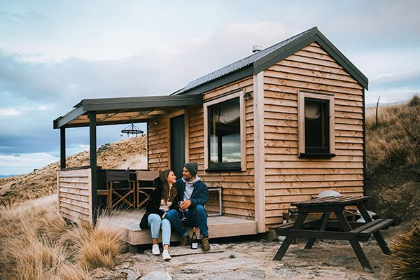 Couple siting enjoying local wines at Henry's Hut
